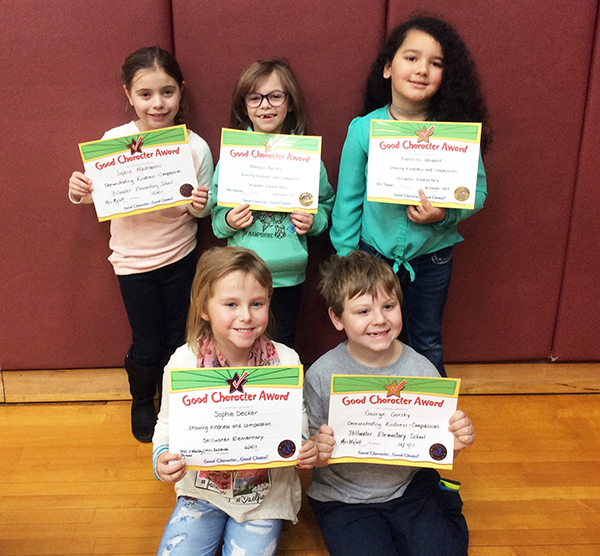 1st graders pose with their Character Education Leader Awards