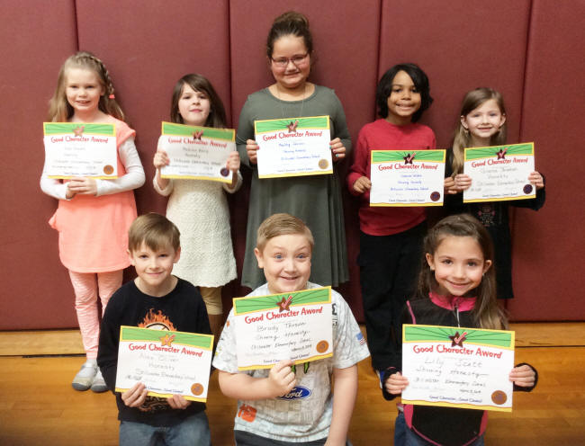 2nd graders pose with their Character Education Leader Awards