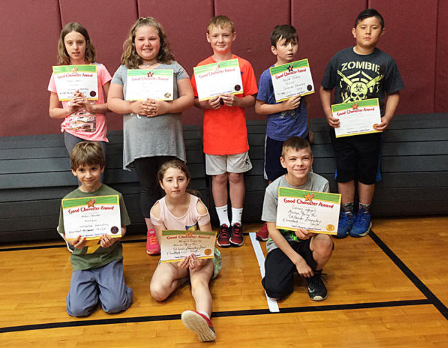 3rd graders pose with their Character Education Leader Awards