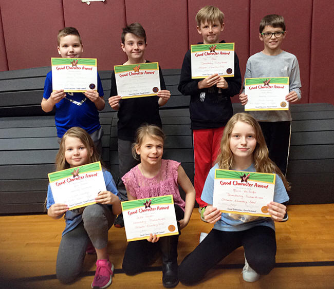 4th graders pose with their Character Education Leader Awards