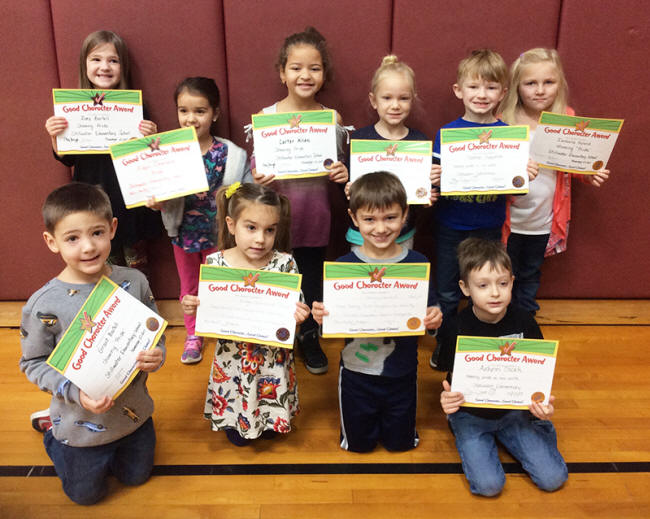 Kindergartners pose with their Character Education Leader Awards
