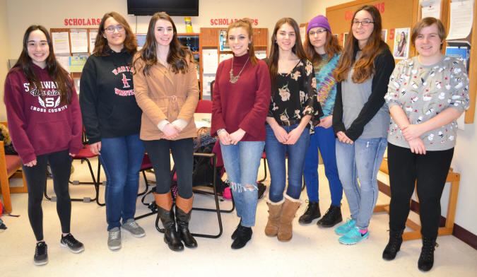 Emma Bisaillon, Alexis Bagramian, Emily Prince, Kaelin Murray, Deanna Gulneck, Rachel Lyman, Madison Krochina and Crescenzia Quantock pose for a picture