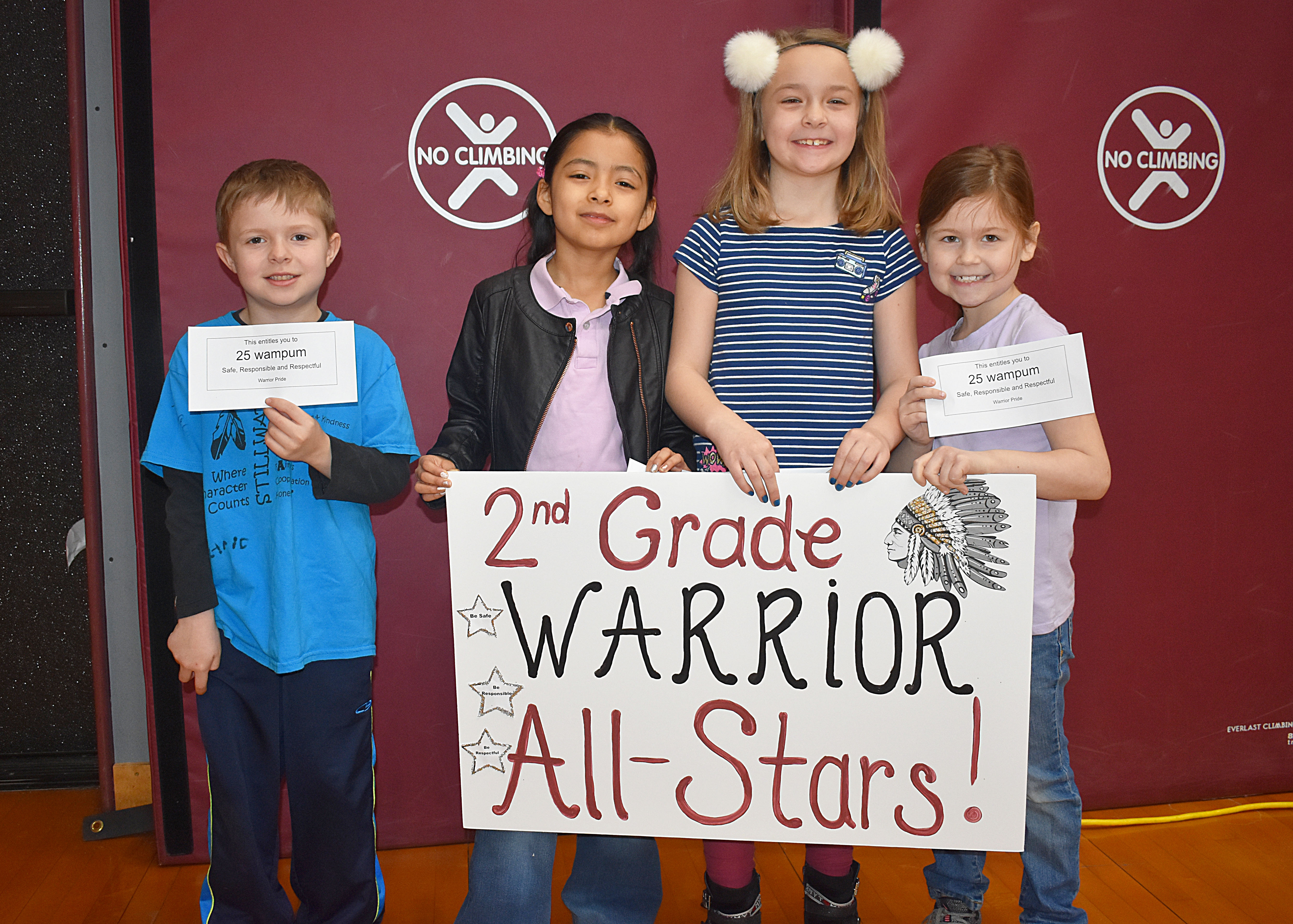 Group of second grade students gathered with second grade sign
