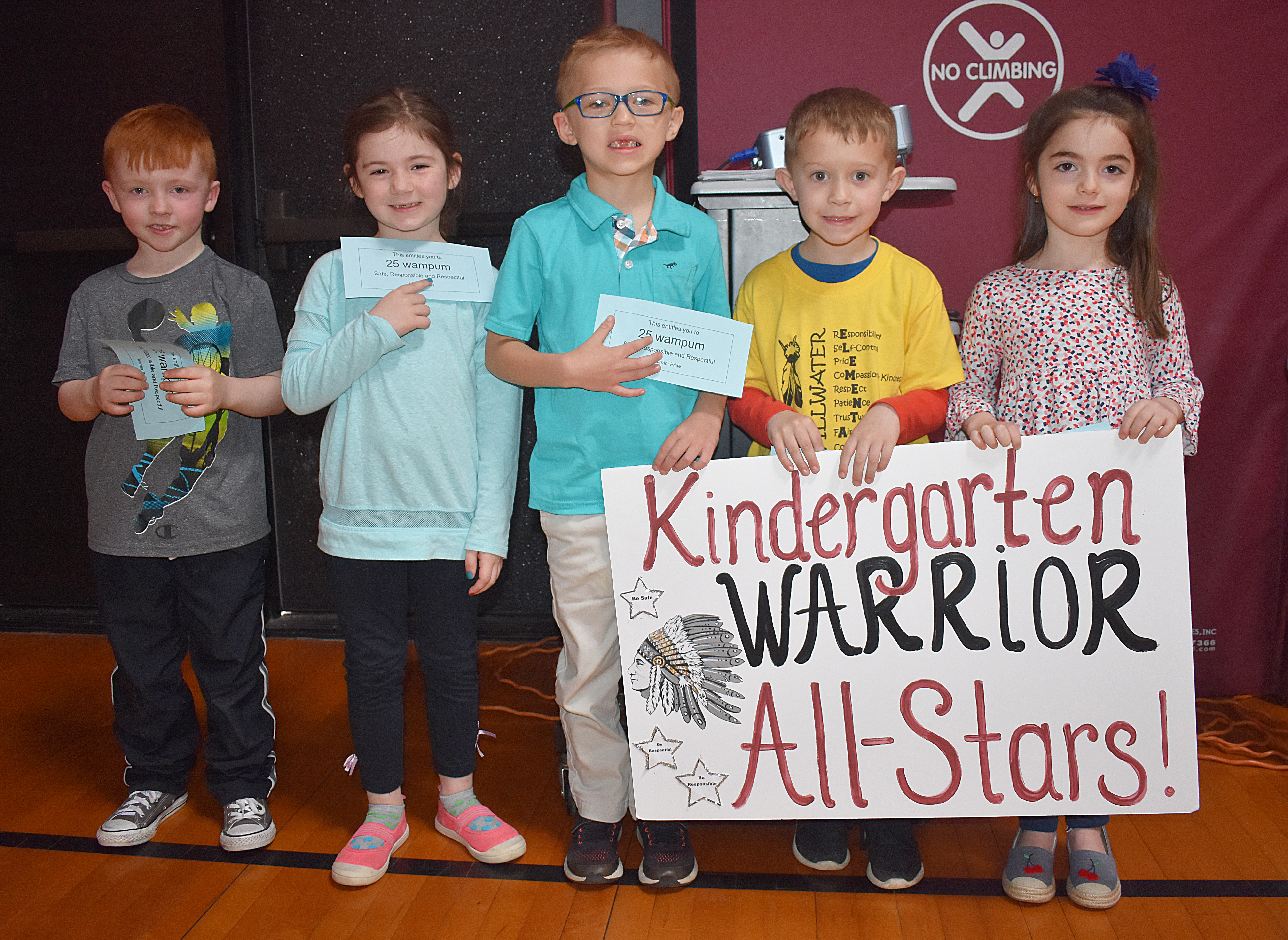 Kids standing with kindergarten sign