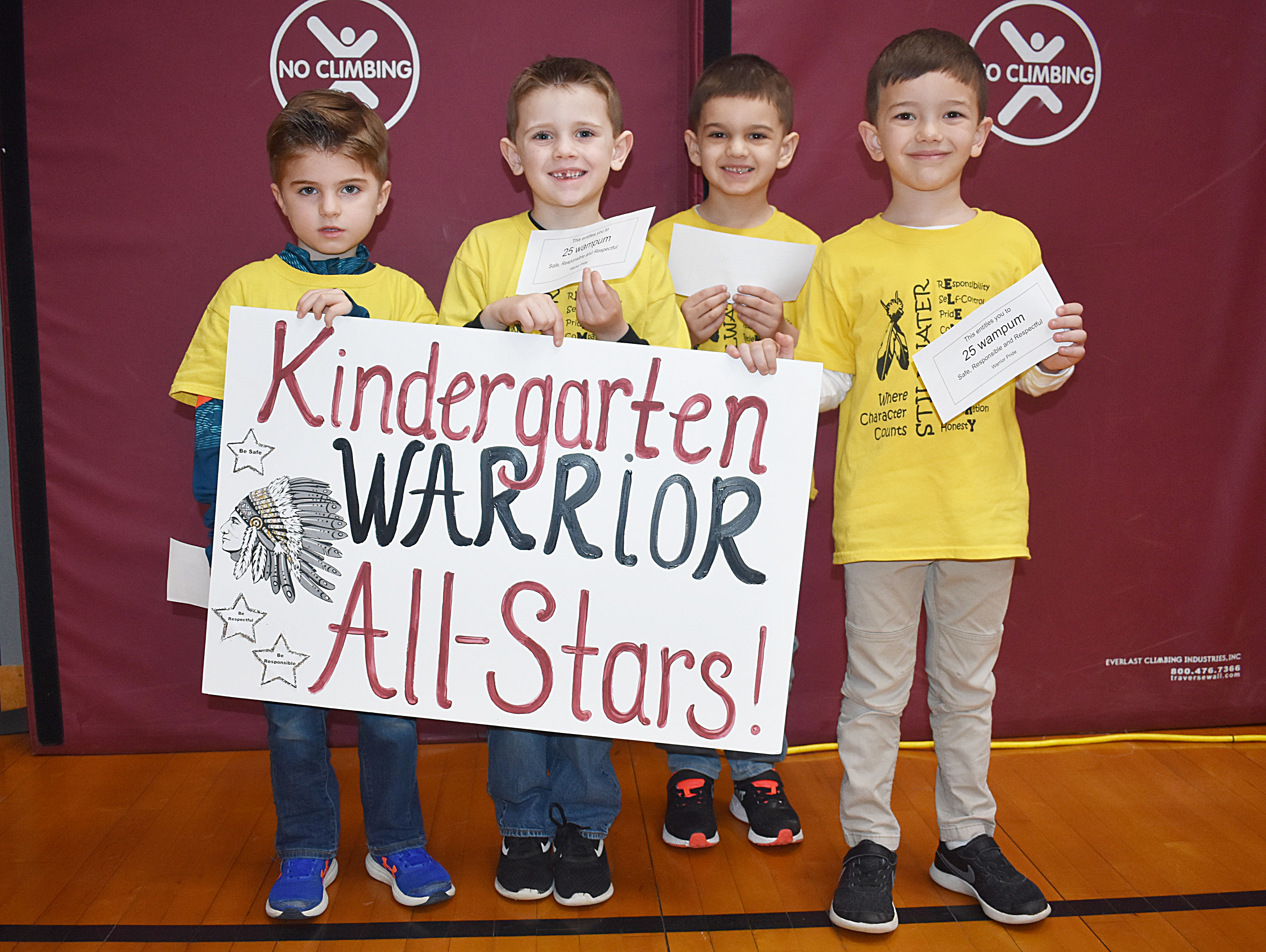 Grouo of kindergarten students gathered together for a picture with their all star sign