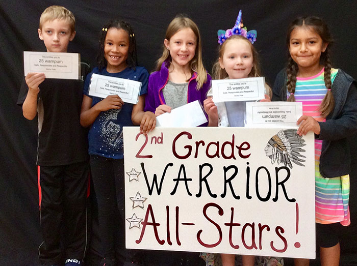 Second grade warrior all stars standing with sign
