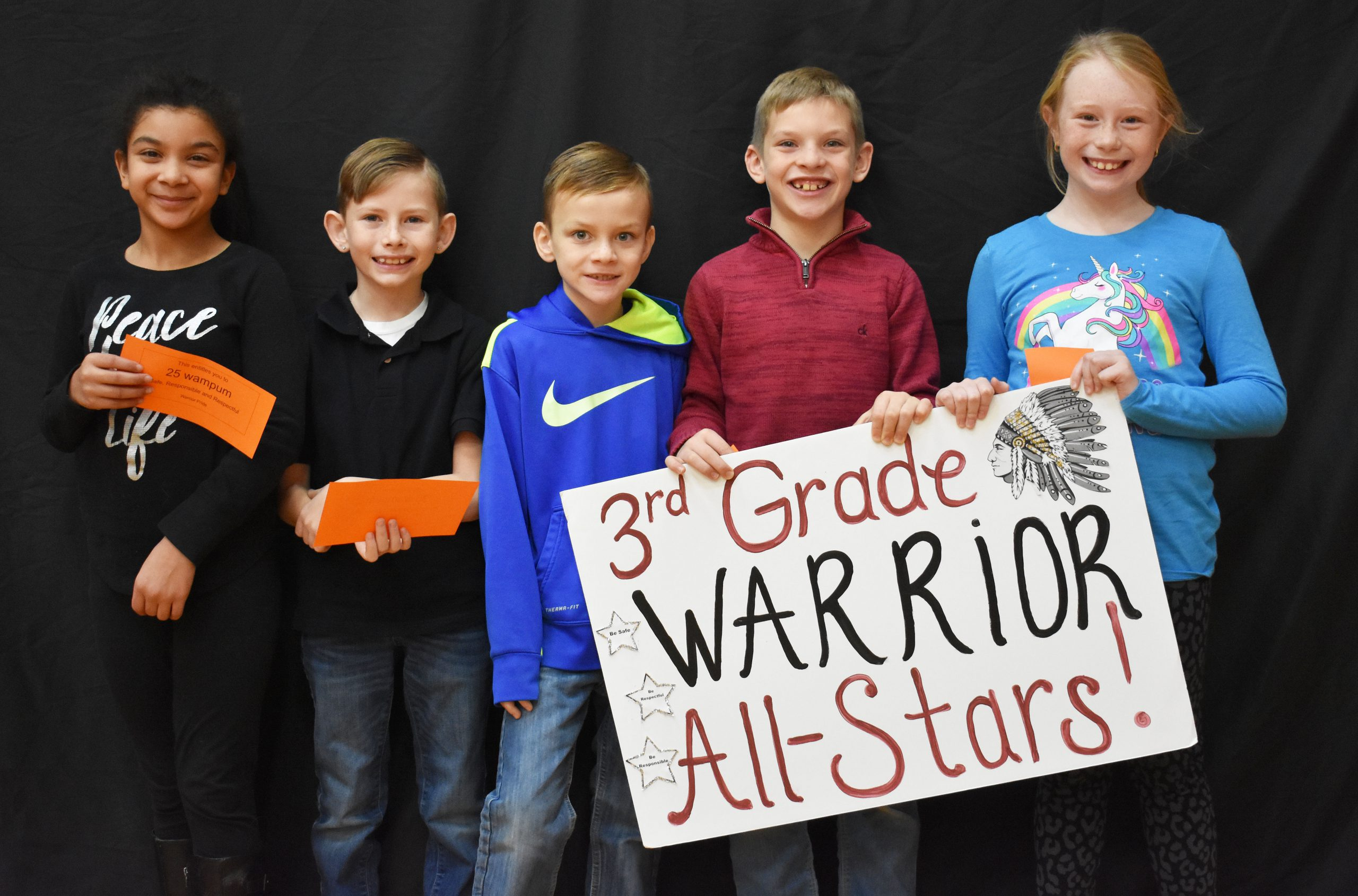 Students lined up with the third grade warrior sign
