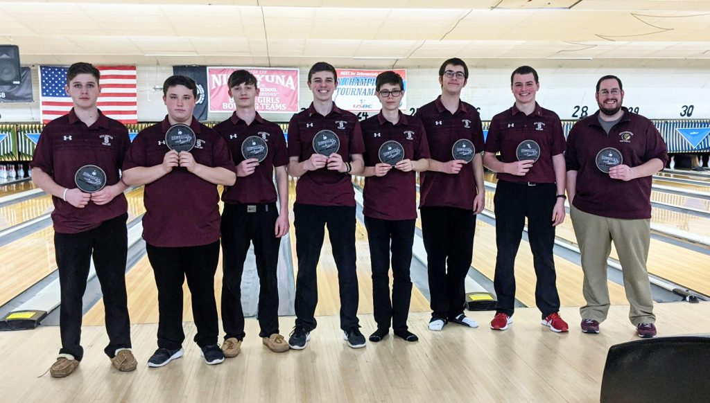 Bowling team lined up with their sectional patches