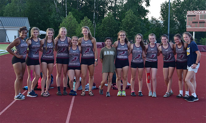 girls varsity track & field team pose as a group at sectionals