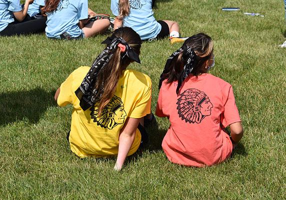 2 students wearing warrior tee shirts