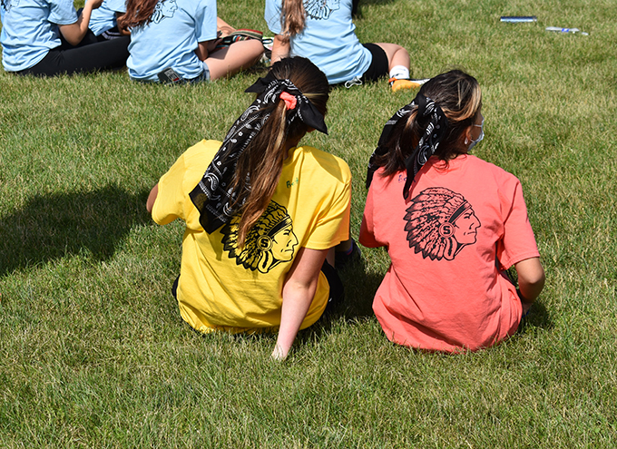 two students on lawn during Warrior Day