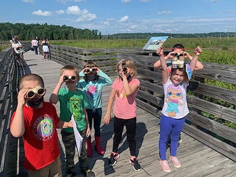 students exploring the Round Lake Preserve